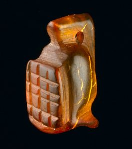 Amber amulet in the shape of a gladiator's helmet. Bloomberg Place 2013. BZY10 [3267] height 13mm